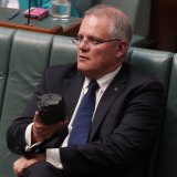 That was then, this is now ... the then treasurer, Scott Morrison, with a lump of coal during question time in Parliament in February 2017.