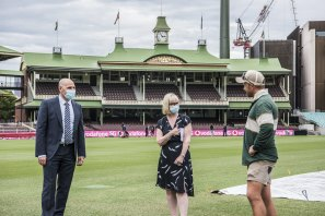 Cricket Australia interim chief executive Nick Hockley, Venues NSW chief executive Kerrie Mather, and Sydney Cricket Ground assistant curator Tom Fahey on Monday.