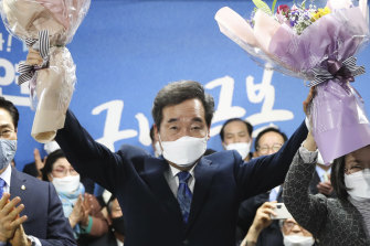 Lee Nak-yon, a former prime minister and candidate of the ruling Democratic Party, celebrates after the election.