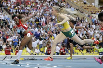 United States' Brianna Rollins, left, gold, and Australia's Sally Pearson, silver, cross the finish line in the women's 100m hurdles final at the Moscow world championships in 2013.