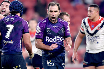 Cameron Smith celebrate the Storm's golden-point win against the Roosters in Brisbane on Thursday night.