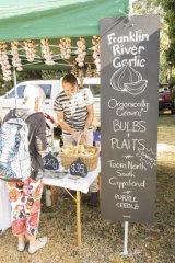 Andris Dinsbergs selling garlic at the Meeniyan Garlic Festival.
