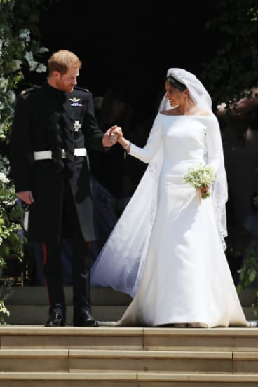Meghan Markle and Britain's Prince Harry walk down the steps of St George's Chapel at Windsor Castle in Windsor, near London, England, following their wedding in May 2018.