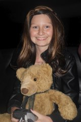 Dainere with her teddy bear Theodore.