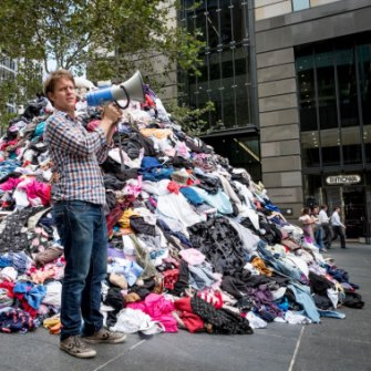 War on Waste host Craig Reucassel with six tonnes of fashion waste.