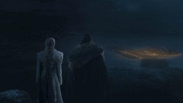Daenerys and Jon survey the battlefield from on high.