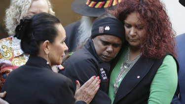 NSW MP Linda Burney, left, and federal Senator Malarndirri McCarthy comfort domestic violence victims' advocate Shirleen Campbell from the  Tangentyere Women's Family Safety Group in Alice Springs.