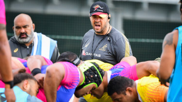 Laying down the law: Michael Cheika oversees a scrum session in Tokyo.