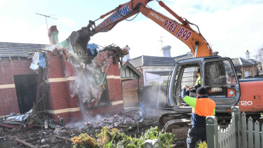 The Elsternwick home being demolished on Thursday.