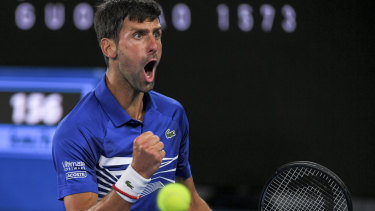 Belligerent: Novak Djokovic wins a key point as he steamrolls Rafael Nadal on centre court.