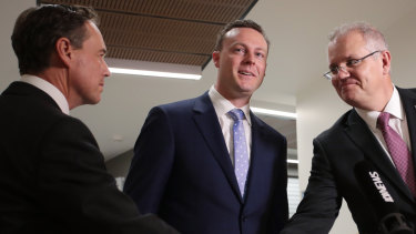 Federal Member for Dunkley, Chris Crewther (centre).