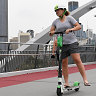 E-scooter spruikers demand law change to allow footpath freewheeling