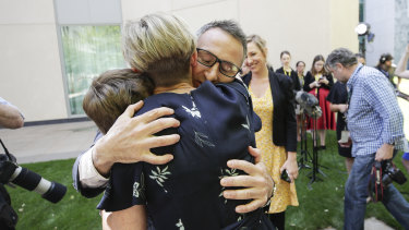 Di Natale embraces his children Luca and Ben and his wife Lucy after announcing his resignation.