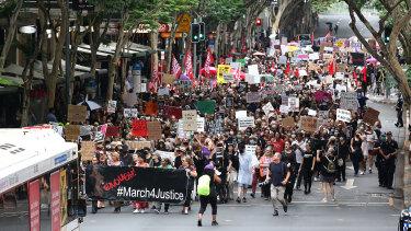 Thousands march through Brisbane.