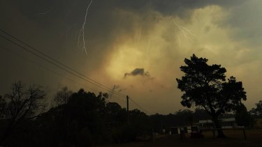 Lightning from a pyroCB storm breaks through while bushfires rage nearby.