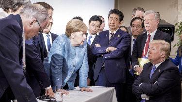 German Chancellor Angela Merkel addresses Donald Trump in Quebec.