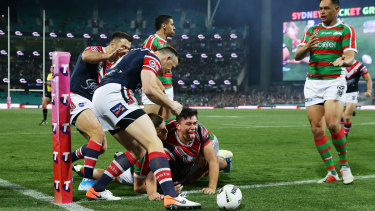 Danger man: Manu goes over in the corner against the Rabbitohs.