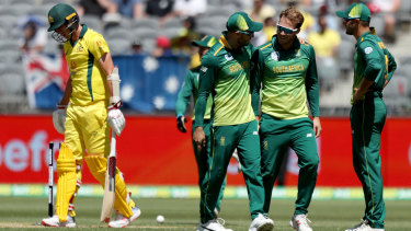 Caught short: South Africa celebrate the run-out of Australia's Pat Cummins during the first ODI of series at Optus Stadium in Perth.