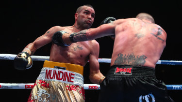 Mundine and John Wayne Parr exchange blows.