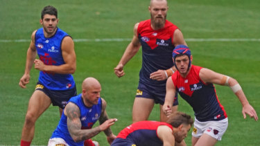 Scratch match: Christian Petracca, Nathan Jones, Jack Viney, Max Gawn and Angus Brayshaw compete for the ball during a Melbourne Demons intraclub match at the MCG on Sunday.