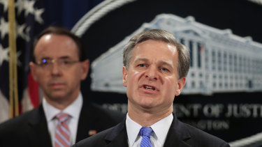 FBI Director Christopher Wray with Deputy Attorney General Rod Rosenstein, speaks during a news conference blowing the whistle on China's hacking operation.