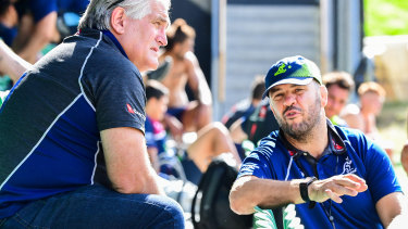 Scott Johnson (left) and Michael Cheika chat during a Wallabies training session in July, 2019.