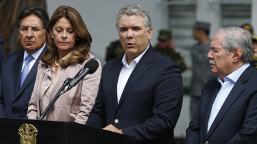 Colombia's President Ivan Duque gives a statement inside the General Santander police academy following the bombing.