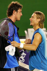 Safin (left) is congratulated by Lleyton Hewitt after the 2005 Australian Open final.