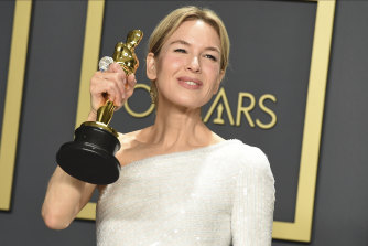 Renee Zellweger poses in the press room with her Oscar for best actress in a leading role.