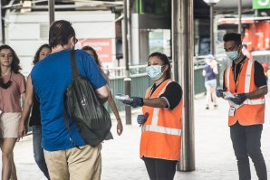 Masks are handed out at Circular Quay in Sydney.