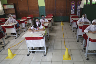 Students sit spaced apart during a class in Bekasi on the outskirts of Jakarta, Indonesia.
