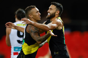 That winning feeling: Shane Edwards, right, celebrates Richmond's win over the Saints with teammate Shai Bolton.