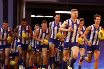 Jack Ziebell leads out the Kangaroos.