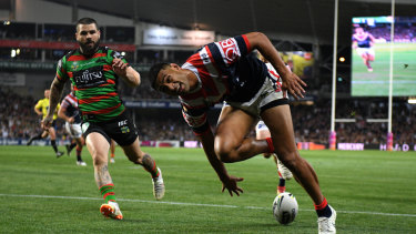 Bragging rights: Daniel Tupou opens the scoring for the Roosters in the first half.