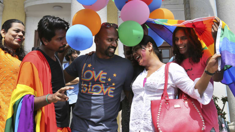 LGBT people and their supporters celebrate in Bangalore after the India's top court struck down a colonial-era law that made homosexual acts punishable by up to 10 years in prison.