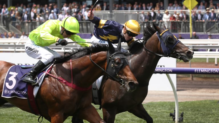 Loyalty Man (yellow cap) holds off Manuel to take out the first race at Flemington.