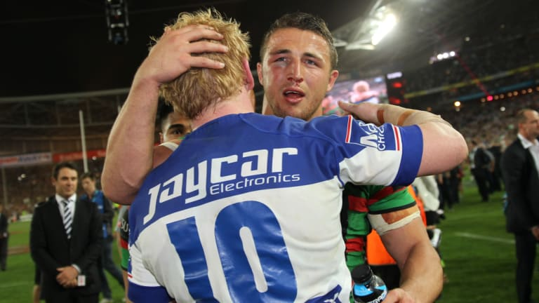 Frenemies: The two English props embrace after the 2014 grand final