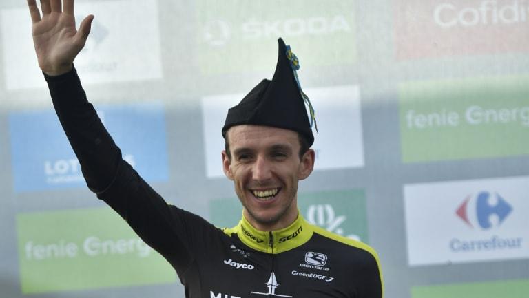 Simon Yates celebrates after stage 14.
