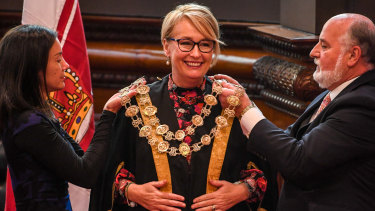 Sally Capp dons the mayoral chains after being elected Melbourne lord mayor at the May by-election.