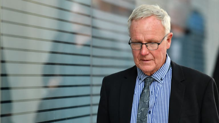 Graham Morant is seen leaving the Supreme Court in Brisbane during his trial.