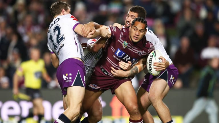 Wriggle room: Manly's Martin Taupau is surrounded by Storm defenders.