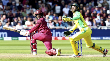 Australia's wicketkeeper Alex Carey, right, reacts after West Indies' Shai Hope, played a shot.