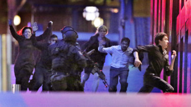 Six hostages escape from the Lindt Cafe in December 2014.