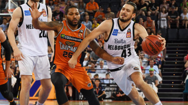 Hard graft: Melbourne's Chris Goulding takes on the Taipans' DJ Newbill at the Cairns Convention Centre.