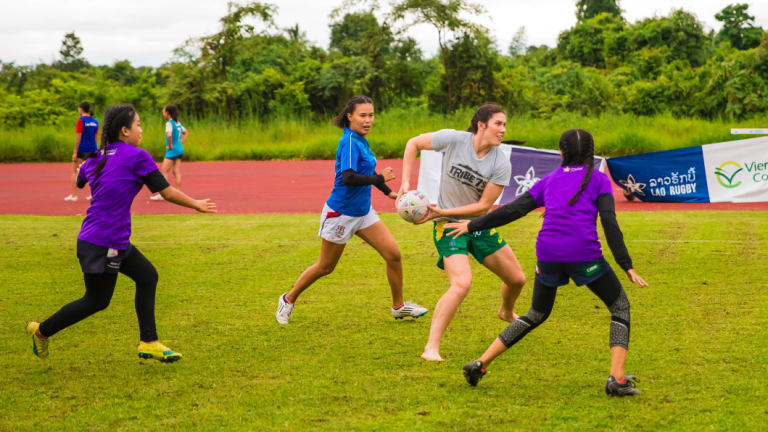 Grassroots: Charlotte Caslick playing rugby with children in Laos with Pass It Back.