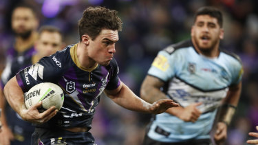 Brodie Croft of the Melbourne Storm makes a run against the Sharks in round 17.