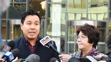 Alpha Cheng and his mother outside court after the person who supplied the gun that killed his father was sentenced.