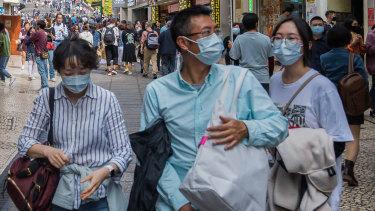 Chinese tourists in Macau wear masks amid the coronavirus outbreak.