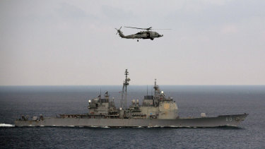 A helicopter approaches to land on the deck of aircraft carrier USS Theodore Roosevelt in 2015.