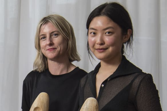 NEWS: Australian Fashion Foundation scholarship winners holding their awards, from left, Helena Dong and Amanda Nichols with judges Simone (right) and Nicky Zimmermann. 18th December 2018, Photo: Wolter Peeters, The Sydney Morning Herald.